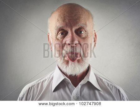 Elderly man making funny jokes