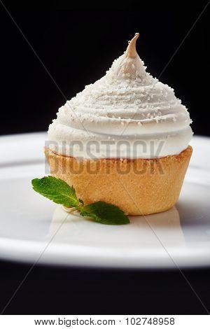 Beautiful cream Cupcake dessert on black background
