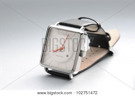 A men's wrist watch with simple and elegant white dial.
