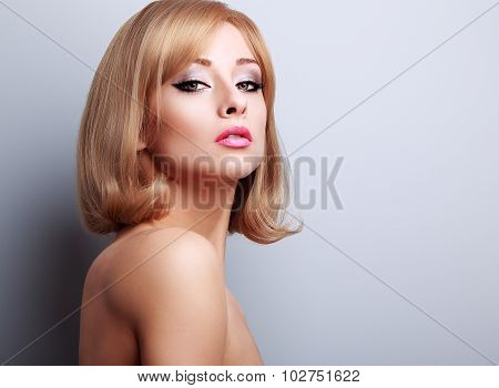 Glamour Elegant Makeup Woman With Blond Short Hairstyle Looking