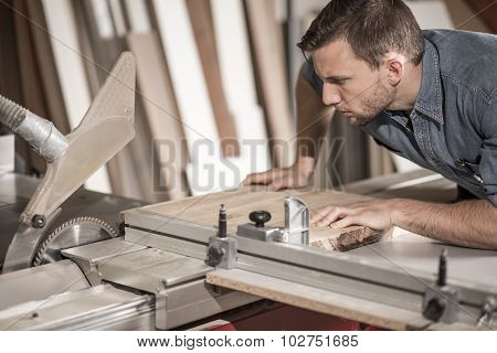 Worker Cutting Wood