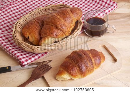 Fresh Croissants With Jam And A Cup Of Coffee For Breakfast