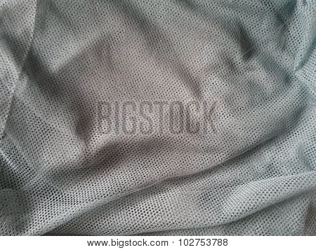 grey fishnet fabric texture useful as a background