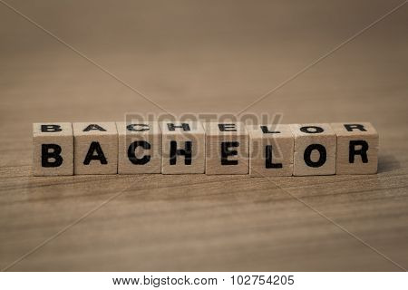 Bachelor In Wooden Cubes