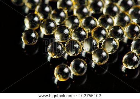 Vitamin A (retinol) Oil Capsules On Black Background
