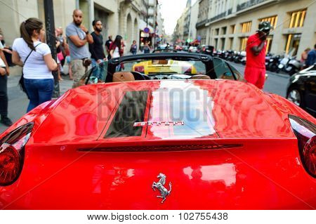 PARIS, FRANCE - AUGUST 09, 2015: close-up shot of Ferrari. Ferrari S.p.A. is an Italian luxury sports car manufacturer based in Maranello. Founded by Enzo Ferrari