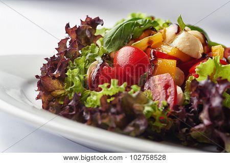 Closeup of vegetable salad on white background