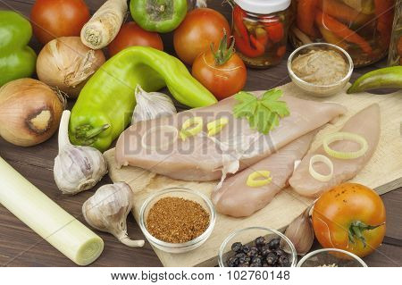 Fresh raw chicken fillet and vegetables prepared for cooking. Fresh raw chicken breasts