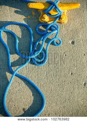 Mooring Bollard With Rope On Pier By The Sea