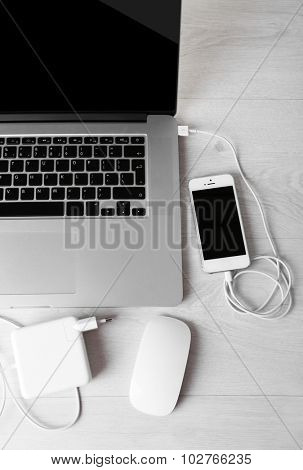 Computer peripherals and laptop accessories on white wooden background