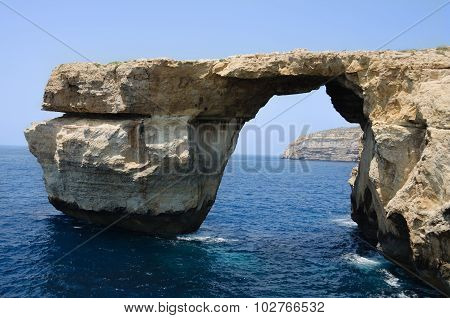 Arch In A Rock By The Sea