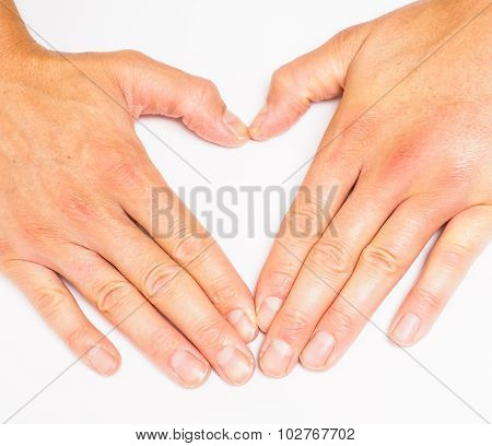Adult Person Creating Heart With Hands Towards Grey White