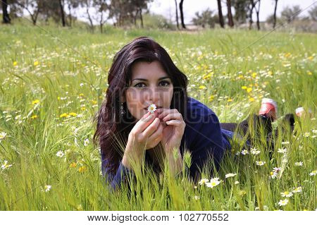 Young Woman Lying On A Meadow