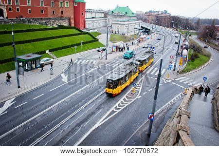 Yellow tram rides under the bridge in the old town of Warsaw, Poland, 03 november 2013 year