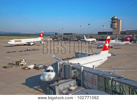ZURICH - JULY 18: Swiss airlines at terminal A of Zurich airport on July 18, 2015 in Zurich, Switzerland. Zurich airport is home for Swiss Air and one of biggest european hubs.