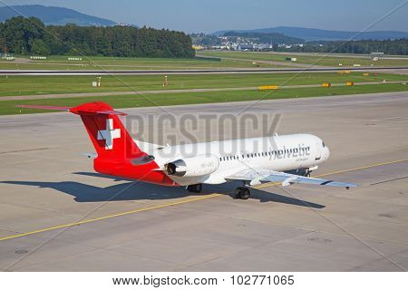 ZURICH - JULY 18: Helvetic airways taxiing in Zurich after short haul flight on July 18, 2015 in Zurich, Switzerland. Zurich airport is home for Swiss Air and one of biggest european hubs.
