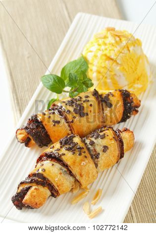 chocolate chip croissants with scoop of ice cream on white rectangular plate