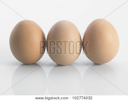 three eggs isolated on white background