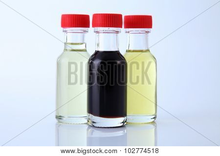 three bottles of food coloring