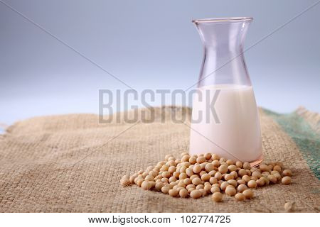 soy bean and bottle of soy milk on the sack cloth