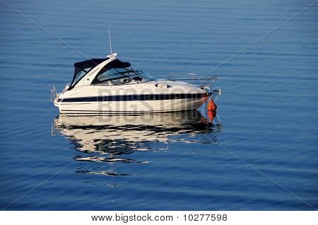 Anchored motor boat