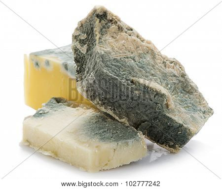 Heap of inedible mouldy cheese isolated on white background.