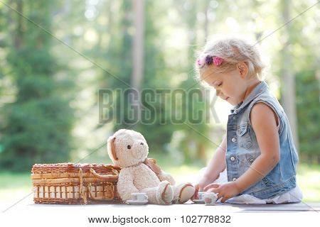 Young Girl Playing With Teddybear
