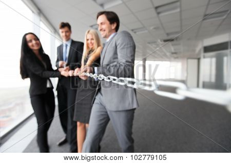 Businessmen Pulling Chain