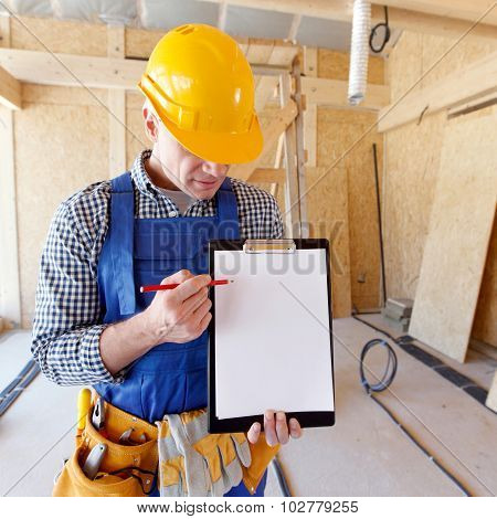 foreman pointing at folder plate