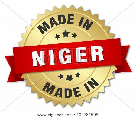 Made In Niger Gold Badge With Red Ribbon