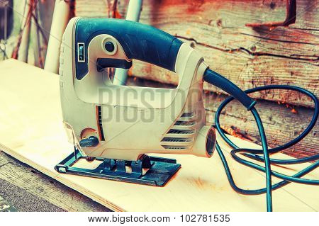 Electrofret standing on hardwood plank, toned image instagram color filter
