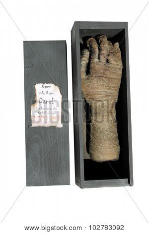 A Genuine Egyptian Cursed Mummy's Hand in an antique wooden shipping box. Isolated on white with room for your text. Egyptian Mummy's are known around the world to be Cursed and come to life to attack