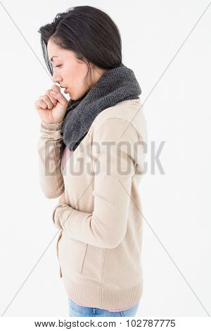 Sick brunette coughing on white background