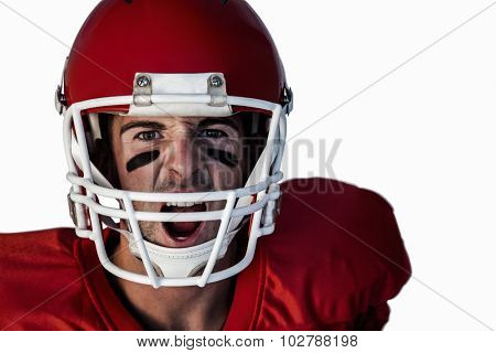 Portrait of rugby player screaming over white background