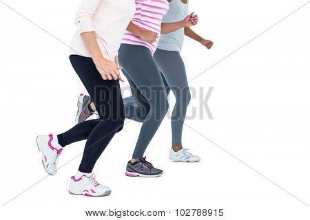 Low section of women jogging aganst white background