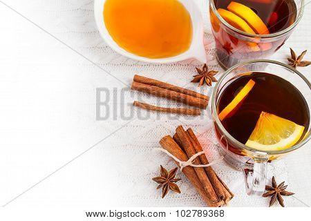 Honey,  Tea With Lemon And Cinnamon Sticks On A White Background