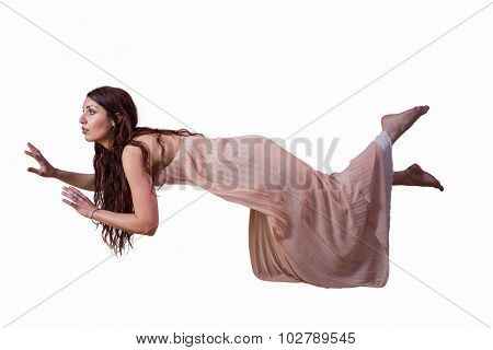 Full length of woman levitating against white background