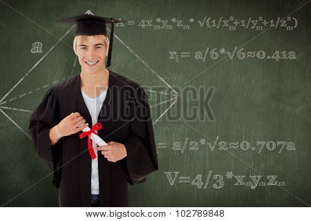 Teen Guy Celebrating Graduation against green chalkboard