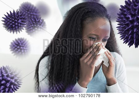 Close up of woman blowing her nose against virus