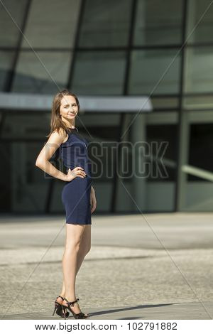 Young slender business woman, business center in the background.