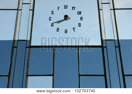Inverse clock blue background