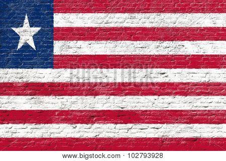 Liberia - National flag on Brick wall