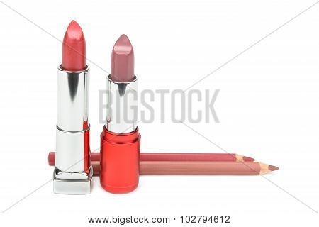 Lipsticks And Cosmetic Pencils Isolated On A White Background