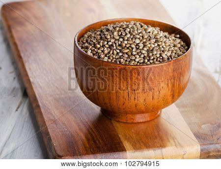 Hemp Seeds On  Wooden Background.