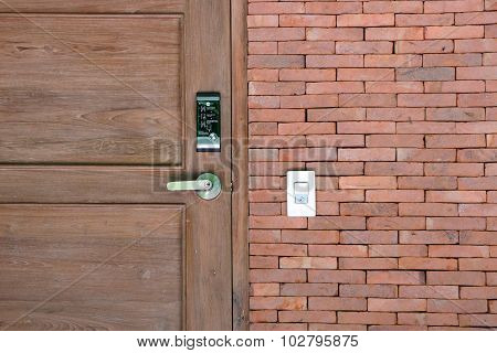 Wooden Door And Electronic Lock With Brick Wall