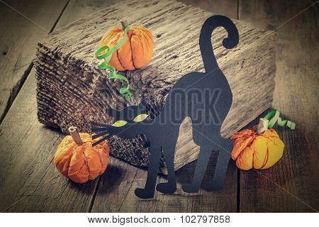 Symbols Of Halloween: A Black Cat And A Pumpkin Made Of Paper