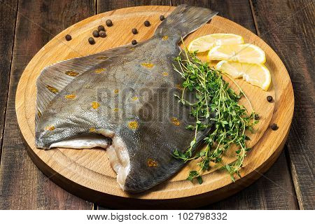 Raw Plaice With Pepper, Thyme And Lemon On The Board