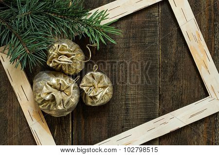 Christmas Bags With Gifts In The Frame With Spruce Branches