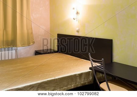 Bed In A Bedroom In Shades Of Yellow