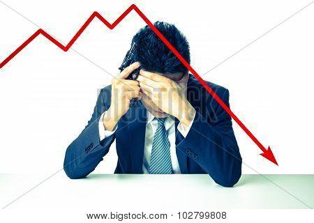 The depressed businessman holding a gun behind bad Stock market chart